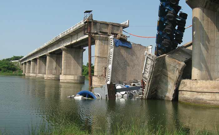 A bridge collapse over water.