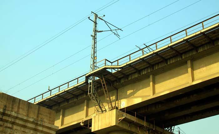 Power lines spanning a bridge.