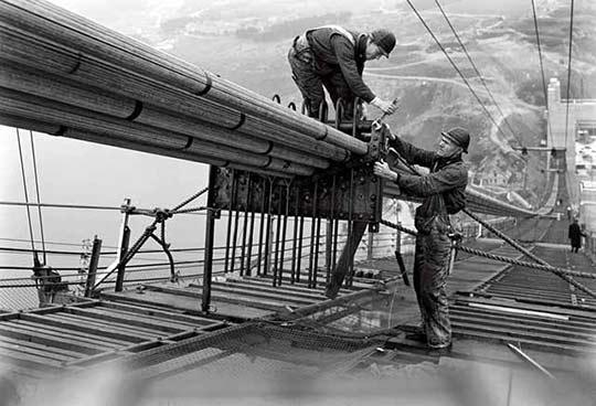 Construction workers building the Golden Gate Bridge.