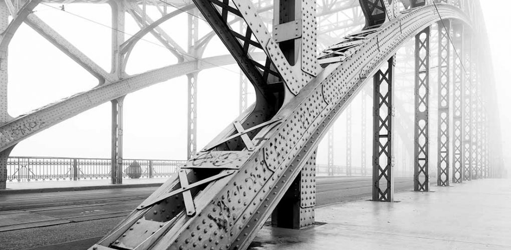 A steel bridge in black and white