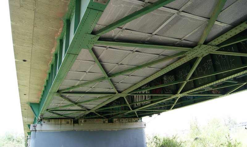 First Line fire blanket installed under a bridge