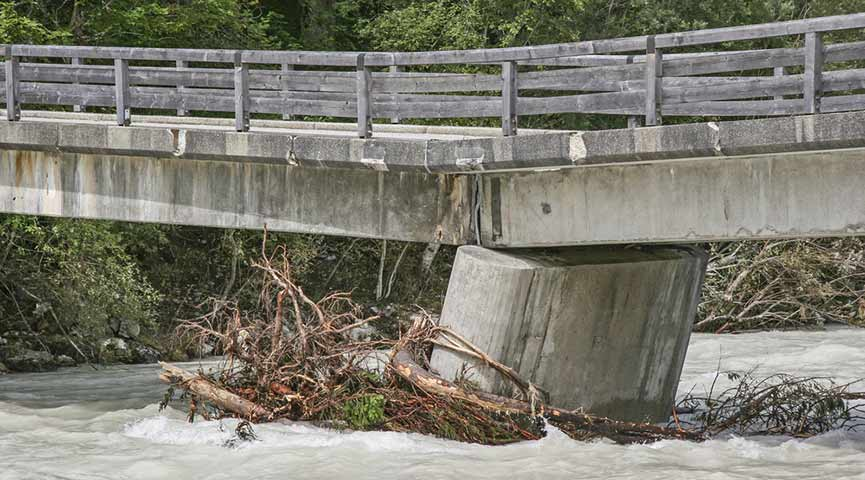 flooded bridge with structural damage