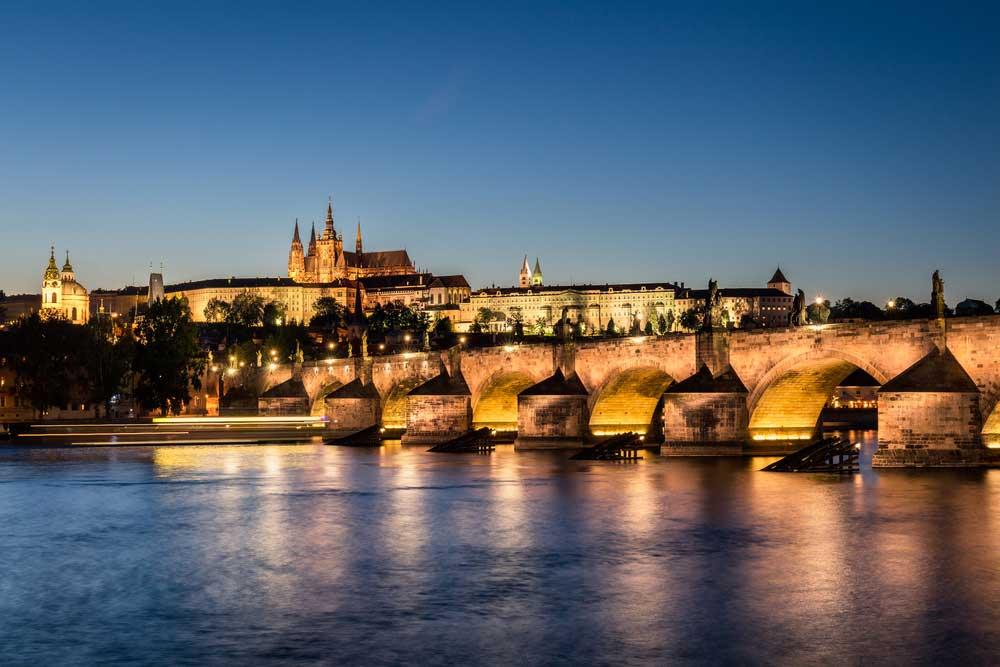 The Charles Bridge enhances the Prague cityscape at sunset.