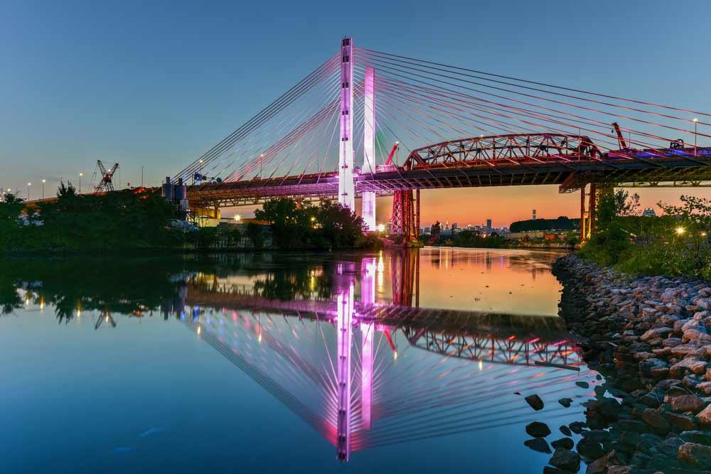 Nighttime view of the Kosciuszko Bridge in New York City.