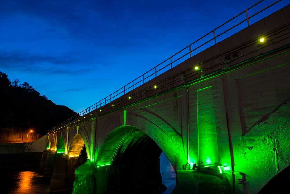 Stone Bridge glows with green light.
